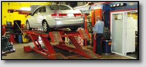 Car on Lift at Precise Auto Service