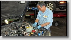 Mechanic Working on Engine at Precise Auto Service